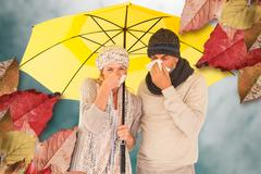 Composite image of couple sneezing in tissue while standing under umbrella Stock Photos