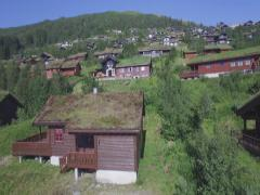 Traditional grass roofed vacation Hytte, Myrkdalen, Vossestrand, Western Norway Stock Footage