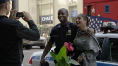 White citizen posing with black NYPD police officer - racial harmony in NYC 4K - stock footage