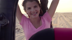 Happy Teen Girl, Riding In Back Of Jeep On Beach, She Holds Up Peace Signs (4K) - stock footage