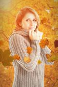Composite image of pretty girl in jumper - stock photo