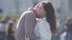 Stock Video Footage of 4K Attractive romantic couple embrace outdoors in the city