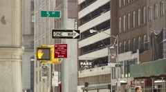 5th Ave sign with one-way arrow for traffic and taxicab driving in Manhattan NYC Stock Footage