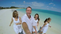 Selfie portrait of Caucasian family enjoying tropical vacation beach Stock Footage