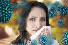 Composite image of brunette with a cold Stock Photos