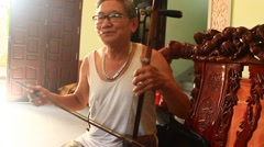 Man playing traditional instruments,Asia Stock Footage