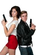Couple with Guns - stock photo