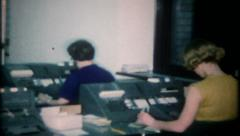 2484 - women work at computer data systems - vintage film home movie - stock footage