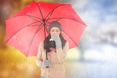 Composite image of sick brunette blowing her nose while holding an umbrella Stock Photos