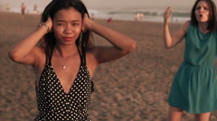 Two young girlfriends fighting, arguing on beach, slow motion shot at 240fps Stock Footage