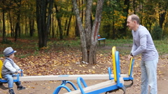 Dad mom and child playing on Playground Stock Footage