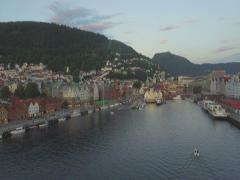 Aerial along the historic harbour district of Bryggen, Bergen, Hordaland, Norway Stock Footage