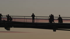 4K Tourists silhouetted against the sky on London Millennium Bridge Stock Footage