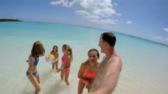 Caucasian family in swimwear filming video selfie on beach Stock Footage