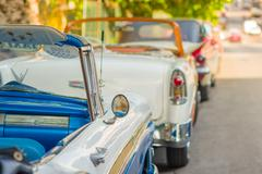 HAVANA, CUBA - AUGUST 30, 2015: Old classic American cars used for taxi and - stock photo