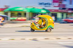 HAVANA, CUBA - AUGUST 30, 2015: Cocotaxi cars used for taxi and tourist - stock photo
