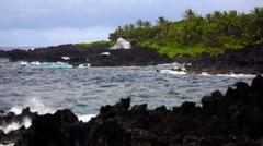Waves Break Against Volcanic Rocks in Maui, Hawaii Stock Photos