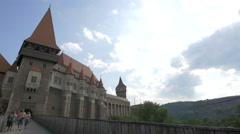Tourists coming out from the Corvin Castle, Hunedoara - stock footage