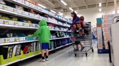 Mother buying some office supplies for her children back to school stuff Stock Footage