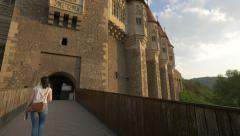 Girl going inside the Corvin Castle, Hunedoara Stock Footage
