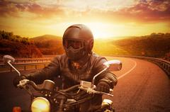 young man riding motorcycle - stock photo