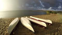 Boats on resort beach sand near sea and rain drops in wind, timelapse 4K - stock footage
