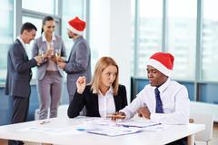 Christmas eve in office - stock photo