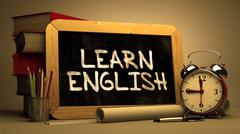 Learn English Concept Hand Drawn on Chalkboard - stock illustration