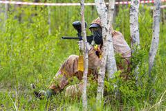 Paintball ambush in birch trees - stock photo