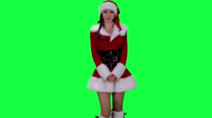 Sexy Santa's helper demonstrates an object chroma key (green screen) Stock Footage