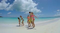 Caucasian family wearing swimwear barefoot on beach Stock Footage