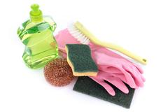 Dishwashing liquid with cleaning equipment - stock photo