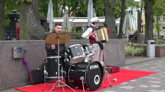 Self taught men play with drum and accordion on street . 4K Stock Footage