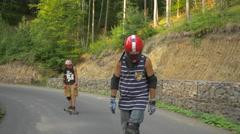 Stock Video Footage of Two longboarders on a curvy road, Hunedoara