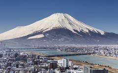 Mt. Fuji with cityspace view surreal shot. - stock photo