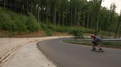 Three longboarders on the road, Hunedoara Stock Footage