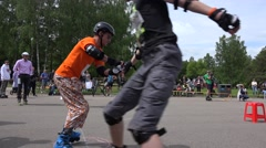 Amateur roller skaters team relay-race relay with barriers. 4K Stock Footage