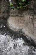Vertical view of old weathered and vintage colonial era wall in Southeast Asi Stock Photos