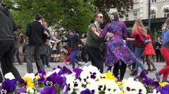 Happy young people in pairs dance lindy hop in city square. 4K Stock Footage