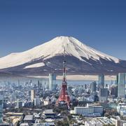 Tokyo tower with mountain Fuji background surreal shot. Stock Photos