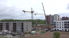 construction crane parts selection in building site. 4K - stock footage