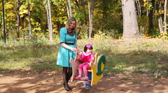 Mother and daughter walking in the park autumn - stock footage