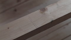 Close up handsaw on wood background - stock footage