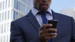 Young African American Businessman Using Mobile Phone Arkistovideo