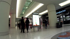 One side of people shopping inside Burnaby shopping mall with 4k resolution. - stock footage