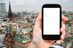 Stock Photo of smartphone with cut out screen and London skyline