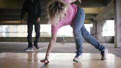 4K Close shot of female breakdancer on the floor, shot on Red Epic Dragon - stock footage