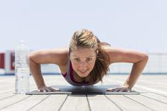 Girl doing push up Stock Photos