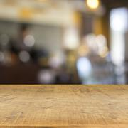 Stock Photo of Blur cafe and wood floor texture background