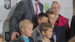 Vitali Klitschko is photographed with the children in the Kyiv metro at the Stock Footage